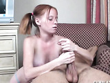 Pigtailed redhead in blue panties masturbating guy's big cock