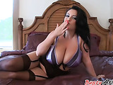 Stockings-clad brunette in a purple bra riding his cock