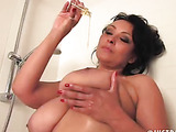 curvy mature plays with her tits and pussy in the shower