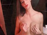 See-through lingerie brunette masturbating on the toilet