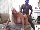 Sexy busty babe with tan lines shoots black dick in her twat.