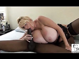 Horny mature girl with large boobs receives anal creampie by the bed.
