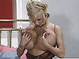 Hot babe sucks her own oversized tits and plays her twat afterwards.