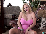 Pink get-up and stripper heels blonde masturbating on a sofa