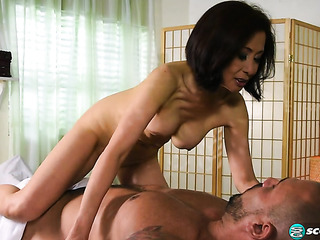 image Asian masseuse riding and tugging her client