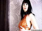 Tight latex brunette MILF with bangs rubbing her tight body