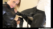 latex-clad blonde ponytailed dominatrix