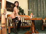 Stockings-wearing brunette with purple makeup gets her pussy licked and dicked