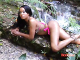 Sexy mocha skinned hottie wears army printed bikini and heels during a garden photoshoot and shows her cute tattoos by the waterfall