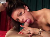Skinny brunette with long legs gets fucked from behind on a red bed