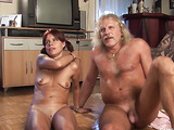 Old man and a pee-covered redhead with a mannish face talk about their scene