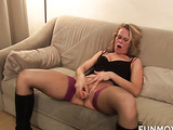 Fishnets-wearing blonde MILF with glasses torturing her slaves