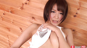 short-haired brunette swallows sperm