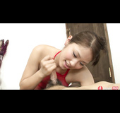 Asian brunette in red bodystocking gives a footjob
