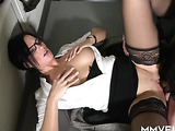 Black-haired secretary in stockings drilled on the floor
