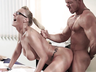 fake-boobed blonde masseuse handles