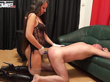 Fat and old brunette mistress fucking her slave with a strap-on