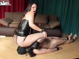 Fishnets-clad mistress torturing her slave's nipples