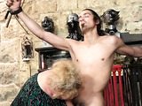 Horny fat granny enjoys torturing and jerking off her young slave