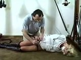 Bound with her mouth taped