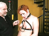 Perky breasted slave has her teats clamped