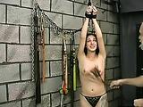 Slave gets her pale skin flogged