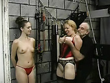 Tied up slave has her boobs abused
