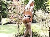 Teen blonde in lingerie in the garden