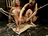Sex crazy bitch ties a horny chick in bondage for their masochistic sexual desires with harness dildos for their wet pussy