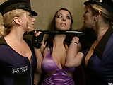 Two attractive policewomen masochistically chained a brunette as they give her such pussy pleasures with their harness dildos and vibrator