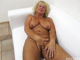 Horny blonde granny with gorgeously big tits getting smashed on couch furiously.