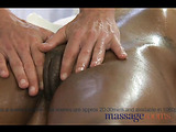 Jaw-dropping black haired ebony receives a furious fingering after her oil massage.
