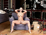 This black haired caucasian loves to display her gorgeous big tits and unshaven wet pussy.