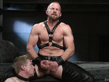 Blonde twink bound and jeered with anal ball-hook by a kinky master in leather pants