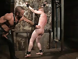 Red dude with moustache gets high being tortured by bdsm master