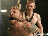 Gagged dude roped and suspended gets his bottom screwed with a master's dick