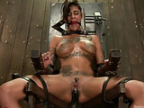 Cute brunette with huge tattooed tits squirting heavily while bound and drilled with a fucking machine