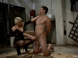 Blonde maitress in fishnet torn pantyhose torturing a bound dude before assfucking with a strap-on