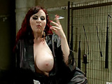 Tattooed red MILF with enormous boobies torturing a dude with a chastity belt in his dick