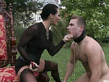 Enslaved dude in a dog leash gets jeered and assdrilled with a strap-on by hot brunette milf in sexy outfit and stockings