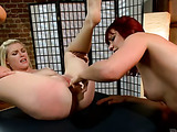 Ginger bitch ropes and fucks with a strap-on her blonde busty masseuse