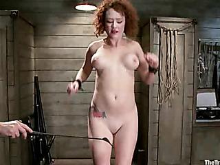 tattooed curly redhead jeered
