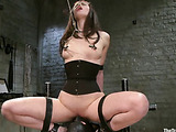 Brunette chick in a black corset totured with various bdsm implements while being punished and fucked hard