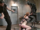 Ponytailed ginger babe with big tits in a collar getting jeered and assfucked hard by a guy in a latex suit and mask