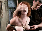 Busty curly redhead gets all her holes warmed up with various bdsm devices, roped and chains