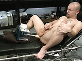 Tattooed gay with a pierced dick gets high while getting his asshole drilled with a fucking machine