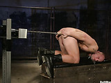 Bald dude enchained gets assfucked hard in the prison with fucking machines