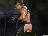 Tattooed hunk in leather pants is happy to get his pooper pounded with a sybian