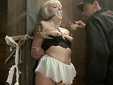 Inked blonde girl gets bound to the stall for band tortures and fucking by kinky master