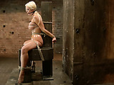 Big-titted blonde bombshell gets flogged before getting roped and stimulated with vibro